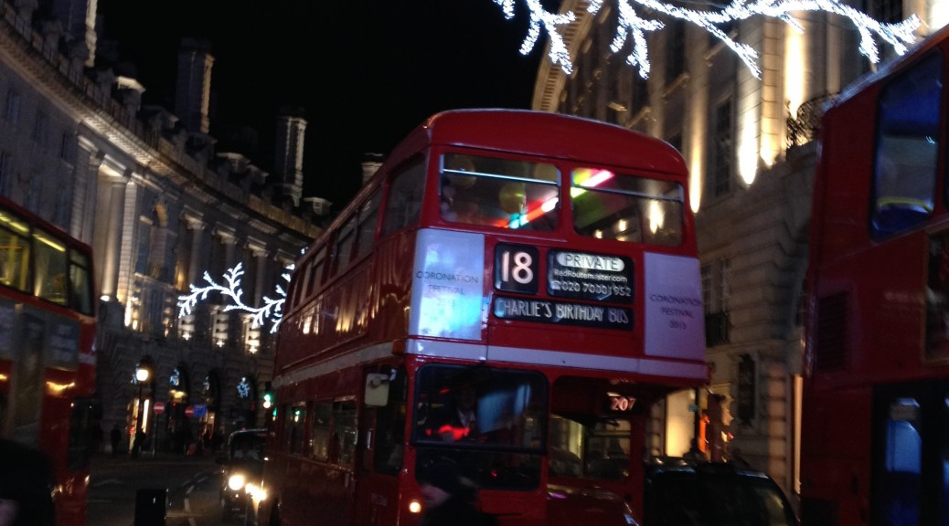 See the christmas lights on a heritage red London bus